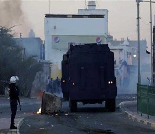 File photo shows Bahraini regime forces attacking protesters in the western village of Shahrakan. (Photo by AP)