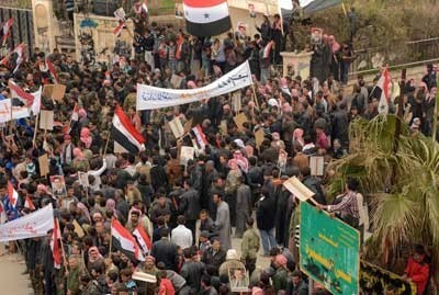 Civilians on February 15th, 2014 rallying for the Syrian Arab Army in Al-Safira