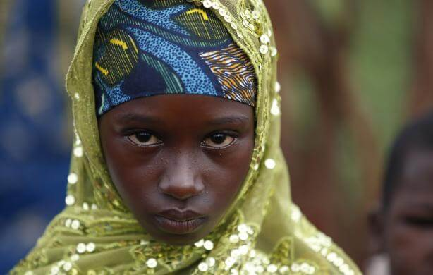 Girl from Puel tribe stands in a village outside Bambari