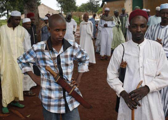 Men from Puel tribe stand in front of a mosque in a village outside Bambari