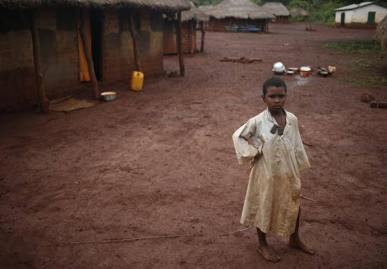 Boy from Puel tribe stands in a village outside Bambari